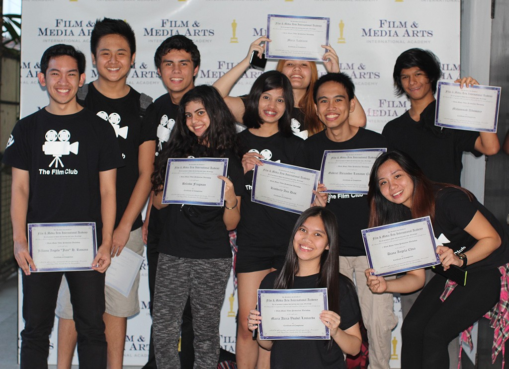 Ten members of The Film Club of Southville Manila ham it up during their graduation exercise from FMA's Filmmaking workshop. L-R: Jian Romano, Joshua Chua, Bill Ivarsoy, Bella Fragman, Kimberly Dias, Maija Lahtinen, Gab Claudio, and Mu Aldossary. Foreground: Alexa Leonardo, and Yana Chua, College of St. Benilde